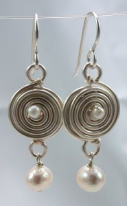These earrings are made with silver art wire, sterling headpins/earwires and pearls.
